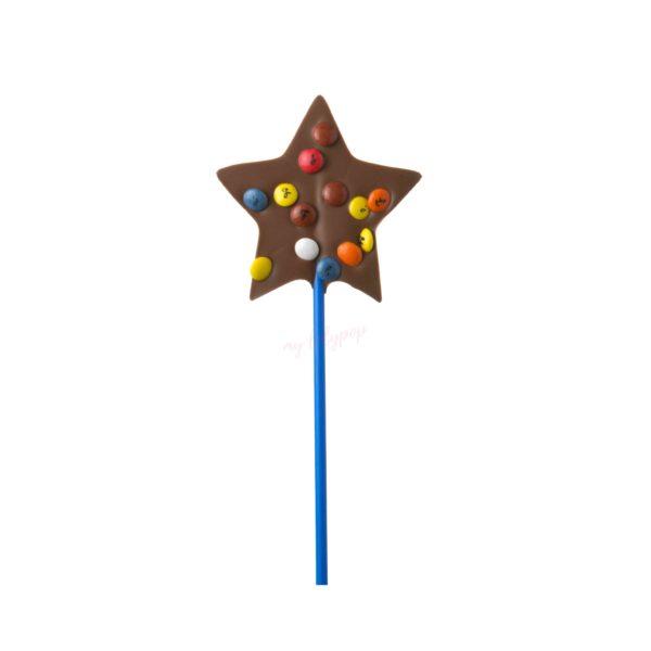 Piruleta de chocolate con forma de estrellas y lacasitos